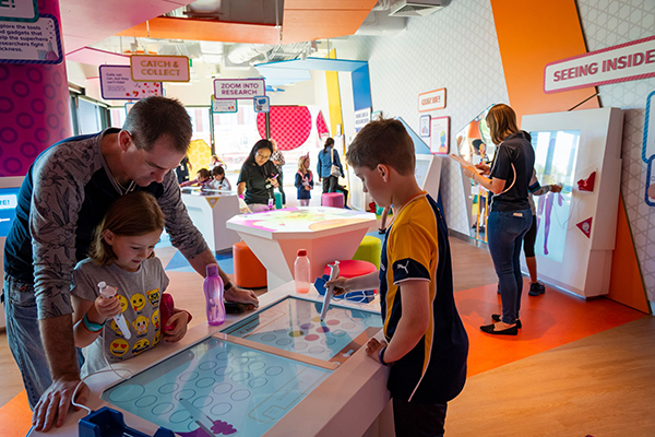 Dad and kids inside at Telethon Kids Discovery Centre
