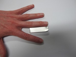 Zimmer splint (aluminium with foam back) cut to the appropriate length from finger tip to just distal to the PIP joint.