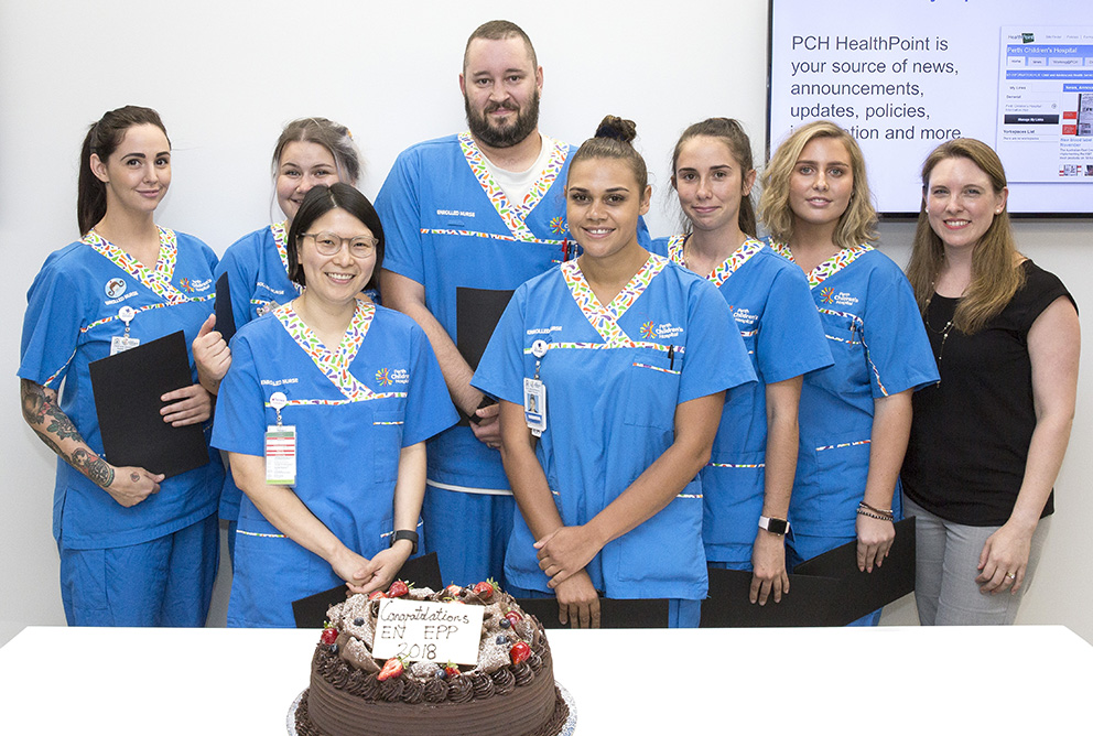 EN Early Practitioner Program graduates for 2018 gathered around a cake