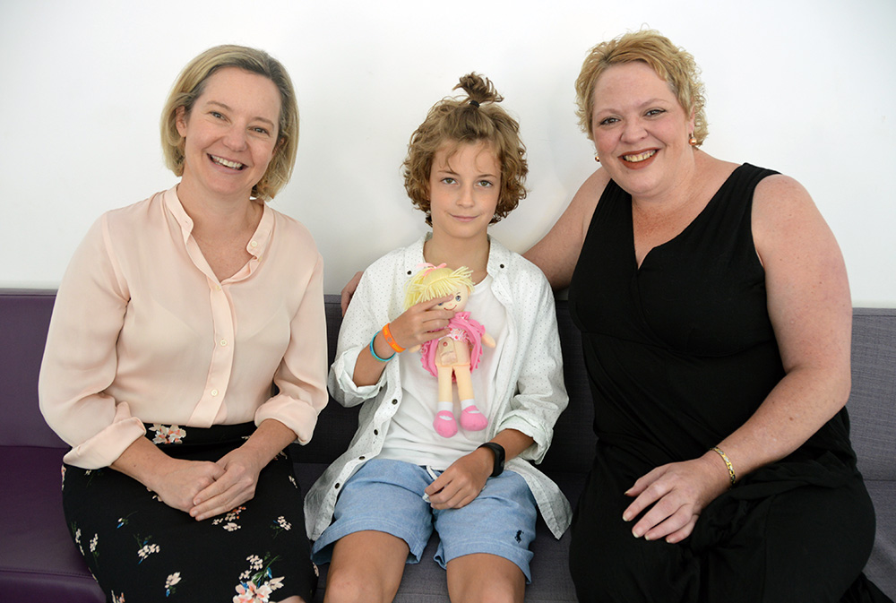 Katie McKenzie (ED of Nursing), Max and Kelly Moss with a stoma doll